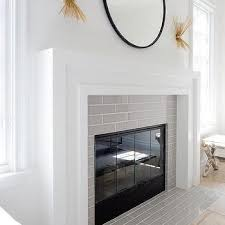 white fireplace mantel with gray tiles