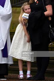 Daughter of PC David Phillips, Abigail Phillips is comforted as ...