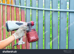 Painting Metal Fence Spray Man Paints Stock Photo Edit Now 1471924853