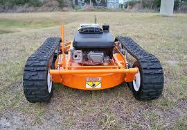 lawn mower tank doubles as snow plow