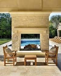 see through fireplace frames the pool