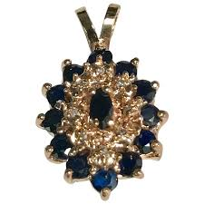 blue sapphire diamond cer pendant