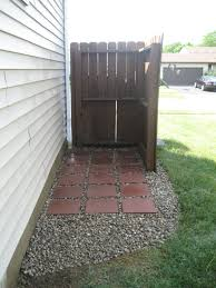 Use For Outside Garden Items Trash Can Area Transformed Using Pavers And Rock Use Squares From Back To Level Front Fo Patio Steps Outdoor Trash Cans Backyard