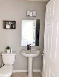 Perk Up Your Powder Room How The Simple Act Of Paint And Wall Decals Can Transform Your Space Dash Lifestyles