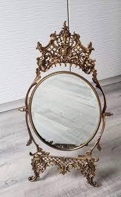 vintage cast brass vanity mirror with