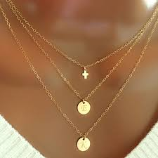 layered tiny cross and disc necklace
