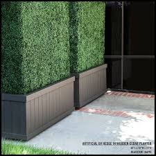 Tall Artificial Hedges In Dark Brown Planters Create A Privacy Wall The Planters Are On Ca Artificial Hedges Artificial Plants Outdoor Small Artificial Plants