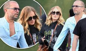 Adele holds hands with Alan Carr's husband at British Summer Time festival  | Daily Mail Online
