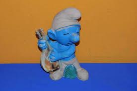 large smurf garden gnome with mandolin