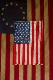 american flag in front of a replica
