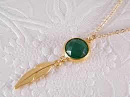 green gem stone pendant gold feather