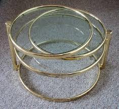 pivoting brass glass coffee table