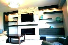 flat screen fireplace above fireplace