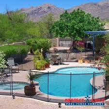 A Beautiful Backyard Oasis Pool And Spa For This Tucson Home Now Secured With Our Pool Safety Fence Learn Pool Patio Beautiful Backyards Beautiful Pools