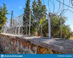 Spiral Barbed Wire Fence On A Brick Wall Stock Photo Image Of Boundary Barbed 164631050