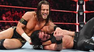 Seth Rollins def. Adam Cole via DQ in main event for NXT Title