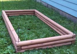 diy raised garden bed with landscaping