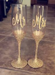 Check Out These Gorgeous Glitter Dipped Decal Champagne Flutes The Mr And Mrs Champagn Decorated Wine Glasses Wedding Champagne Flutes Wedding Wine Glasses