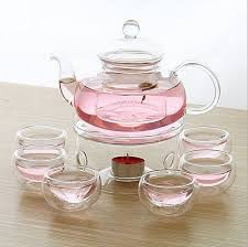 vintage clear glass teapot flower tea