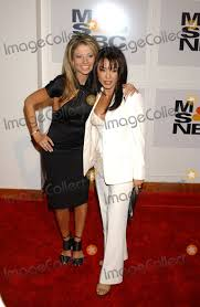 Photos and Pictures - NEW YORK, JANUARY 28, 2005 Sharon Tay and Claudia  Difolco at the MSNBC Entertainment Shows Launch Party held at the Gibson  Guitar Showroom at the Hit Factory.