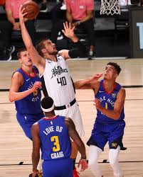 George, Leonard lead Clippers past Nuggets for No. 2 seed