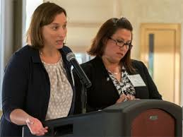 Jennice O'Brien (left) and Abby Dean explain marketing efforts during the  Aug. 7 Strategic Plan Implementation Leadership Retreat. - NIU Today