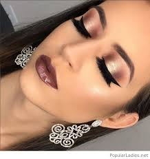 amazing big earrings and glam makeup