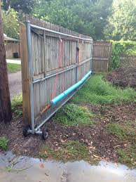 Noodles On Hinges And Pulleys Allow Rolling Gate To Open And Close Things We Do To Keep Our Pets Secured All For Y Sliding Gate Fence Gate Sliding Fence Gate