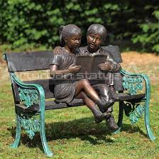 boy and girl reading book statue