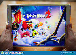 Moscow / Russia - February 25, 2019: White Ipad In Hand. On The Screen, The Game  Angry Birds 2. Editorial Stock Photo - Image of touch, illustrative:  140364108