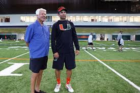 Former coach Jimmy Johnson gives Hurricanes a boost by visiting ...