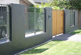 A Front Fence Apinted To Integrate With The House Colours