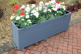 large wooden garden planter trough