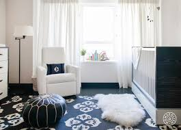 nursery with black and white rug
