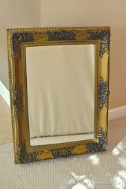 spray painted gold yard mirror