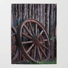 Old Wagon Wheel Leaning Up Against A Stick Fence Poster By Artistallen Society6