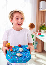Happy Young School Kid Boy Showing The Model Of Solar System Stock Photo Picture And Royalty Free Image Image 136666132