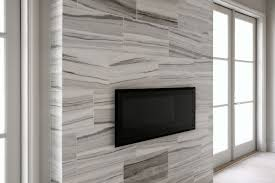 floor to ceiling fireplace with tv