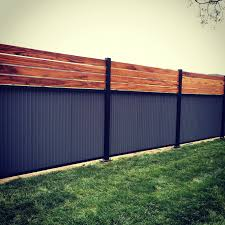 Custom Privacy Fence Built Out Of Metal Post Tiger Wood And Corrugated Metal Privacy Fence Designs Cheap Privacy Fence Diy Privacy Fence