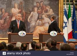 Italian Prime Minister Silvio Berlusconi looks at the 'That's a ...