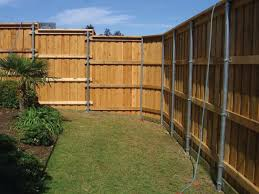 Building A Wood Fence With Metal Posts Wood Fence Building A Fence Wood Fence Design