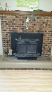 how to install stone over brick fireplace