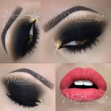 gold and black smokey eye makeup cat