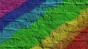 rainbow colored brick wall wallpaper