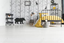 Low Angle Photo Of Kid S Room With Handmade Lamp And Yellow Bedding Stock Photo Picture And Royalty Free Image Image 89820077