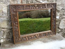 carved oak mirror with seed pods