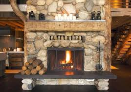 a stacked stone fireplace in modern