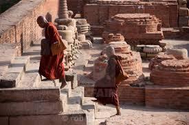 Buddhist monks visiting Dharmarajika Stupa at Sarnath ruins near ...
