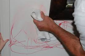 permanent marker from a painted wall