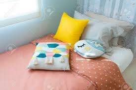 Kid Bedroom With Cute Pillows And Yellow Table Lamp On Side Table Stock Photo Picture And Royalty Free Image Image 140693083